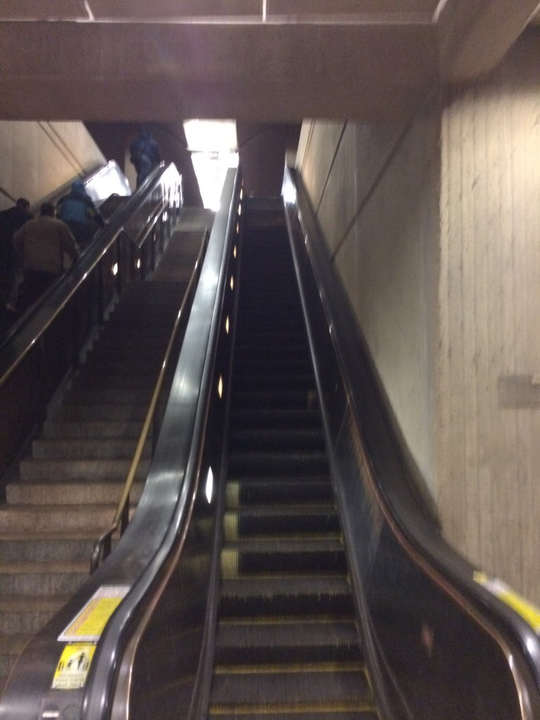 Inside Shady Grove Station escalator down.